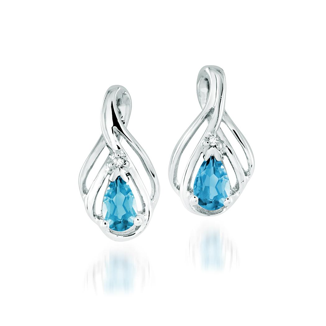 Boucles d'oreilles à tiges fixes en argent sterling serties de topazes bleu de laboratoire et d'une touche de diamant