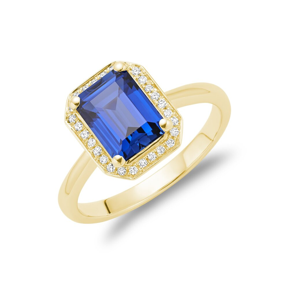 Real stone sapphire ring in 10k yellow gold with diamond 10 pts.